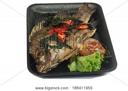 Fried fish (Tilapia) in foam box isolate on white