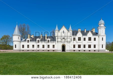 Front view of Alatskivi castle by sunny springtime. Neo-gothic style manor Tartu county Estonia