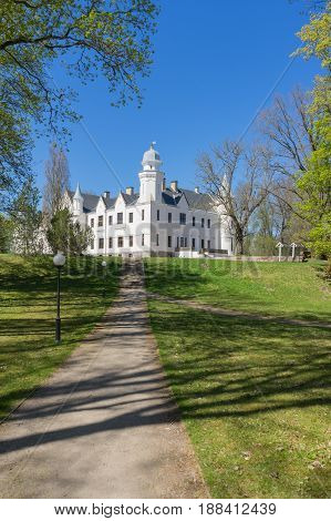 Neo-gothic style castle and manor park by sunny springtime day Alatskivi Estonia