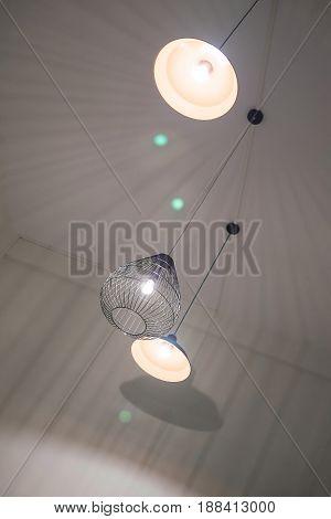 Modern Ceiling Lamps Lighting Equipment In Dark Room Shallow Focus.
