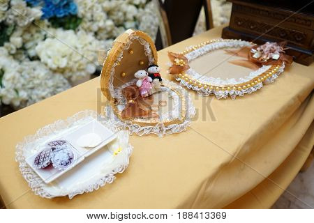 Elegant luxury golden wedding rings on plate and accessories, prepare for holy matrimony wedding in church