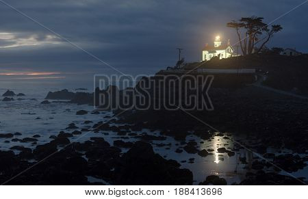 Night falls on a rocky outcropping in Crescent City