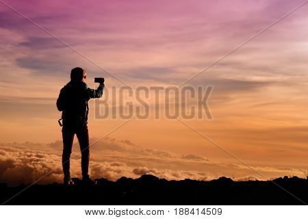 Tourist Admiring Breathtaking Sunset Views From The Mauna Kea, A Dormant Volcano On The Island Of Ha