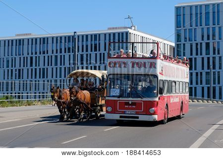 A Doubledecker Sightseeing Busand A Horse Carriage  Doing A Sightseeing Busin Berlin