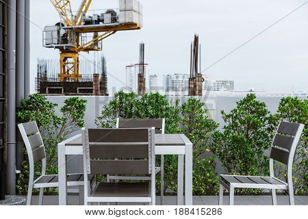 chairs with table on garden deck, background