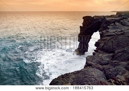 Holei Sea Arch At Sunset. Natural Arch Is Located At The End Of The Chain Of Craters Road In The Vol