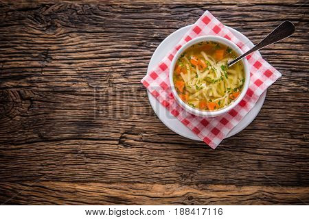 Chicken broth.Beef Broth. Bone broth with noodles carrot and parsley in white bowl.