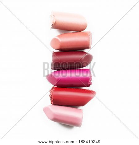 Set Of Different Lipstick Pieces Isolated On White Background. Broken Lipstick. Make Up Collection.