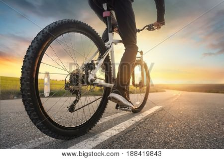 Ride on bike on the road. Sport and active life concept in the summer time