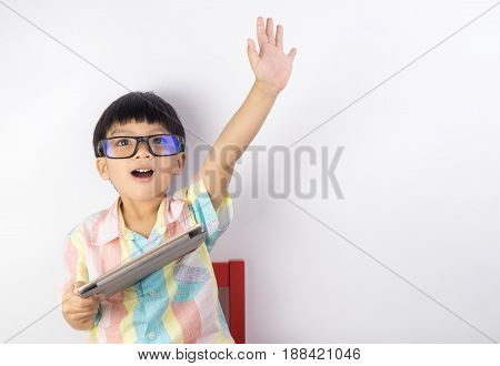 boy holding tablet raise his hand up for children right on internet