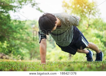 Hand Push-up. Confident Muscled Young Man Wearing Sport Wear And Doing Hand Push-up While Exercising