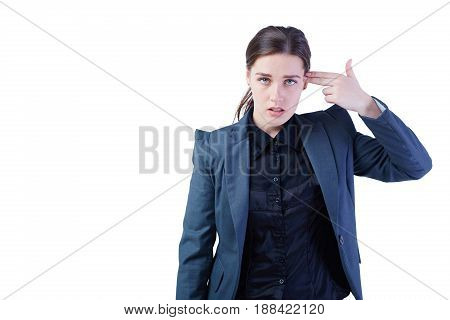 Young business woman with hand to head in the shape of gun. Isolated on white.