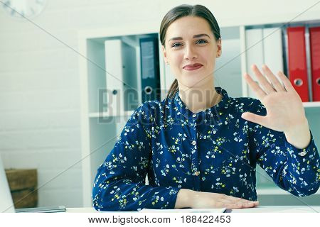 Female secretary says hello with hand. Friend welcome, introduction, greet or thanks gesture, product advertisement, partnership approval, arm, strike a bargain on deal concept