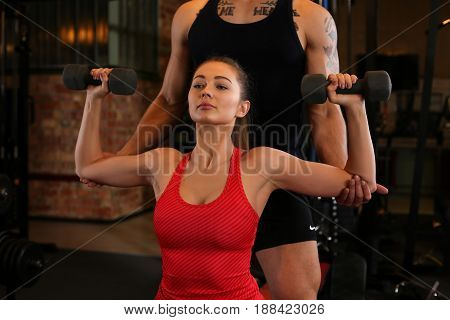 Sporty young smiling couple work out together. Modern athletic family health care heavy work calorie burn diet slim and power people hobby and leisure activity trend action wear shop concept