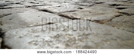 Stone pavement of the road close view background