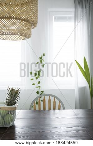 Dining room with rattan lamp and wood table