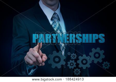 The concept of trusted business partnership. Businessman holds in hands the virtual word.