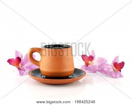 cup of coffee with saucer and artificial orchid flowers isolated on white background, coffee cup and saucer made of baked clay