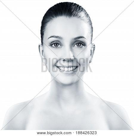 Beautiful young woman with clean skin over white background.