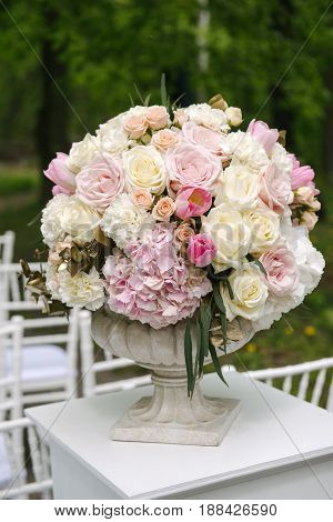 Beautiful wedding bouquet of white and pink roses, tulips and peonies, closeup, outdoors