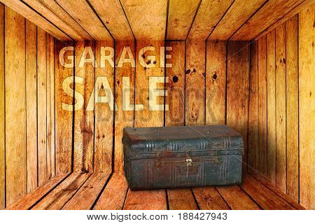 old iron box and garage sale words background in wooden room