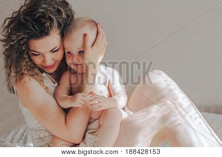 loving mother and baby boy at home
