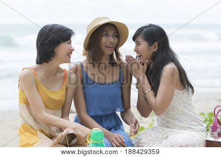 young asian woman relaxing happiness traveling time at sea beach