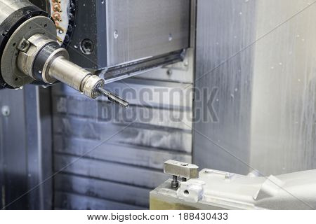 The 5-axis CNC milling machine tapping the automotive part with the tapping tool.Hi-technology machining concept.