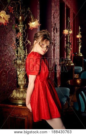 Young fashion caucasian ballerina in red dress