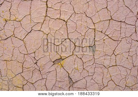 Texture of cracked dye on weathered cement surface
