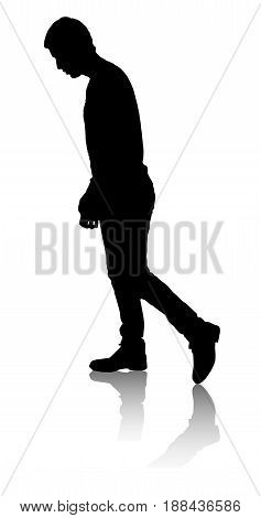 Silhouette of the person who is walking. A man looks down. Slow motion.