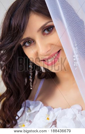 Close-up portrait of a beautiful girl in a dress with a neckline.