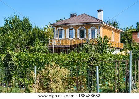 Beautiful Russian wooden house on sunny day in summer