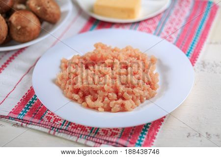 Crude Chicken Forcemeat On A White Plate On A Light Background