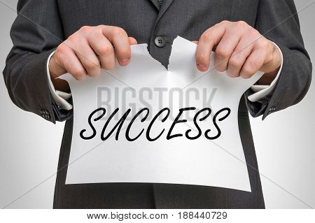 Businessman Tearing Paper With Success Word