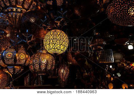 Street shop with traditional lanterns in Marrakech Morocco at night
