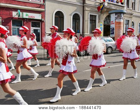CLUJ-NAPOCA ROMANIA - MAY 27 2017: Young majorette girls march on the streets at the opening parade of the Cluj Days festival.