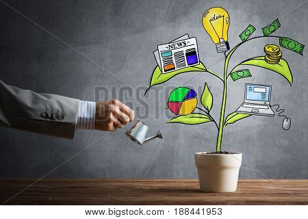 Hand of businessman watering concept of business plan and strategy