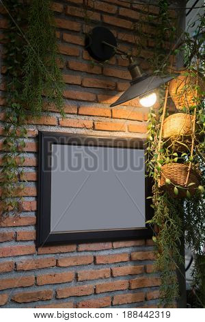 Old Picture Frame Decorated On Brick Wall stock photo