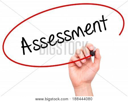 Man Hand writing Assessment with black marker on visual screen. Isolated on white. Business technology internet concept. Stock Photo