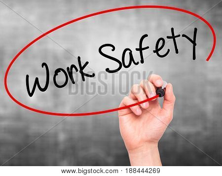 Man Hand writing Work Safety with black marker on visual screen. Isolated on grey. Business technology internet concept. Stock Photo