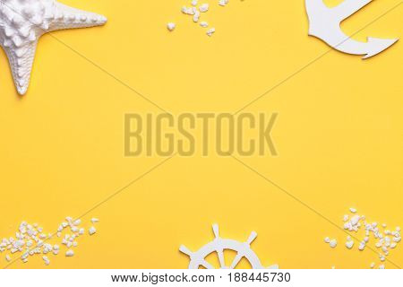 Summer holiday vacation background with starfish anchor and rudder in white. Copy space. Top view