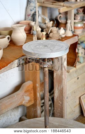 pottery studio, empty potter's wheel, pottery from clay on the table