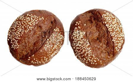 Two rye breads with sesame seeds isolated on white background