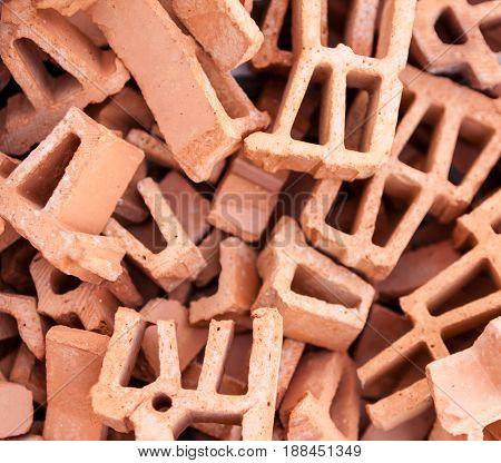 Pile of broken silicate bricks. Close up.