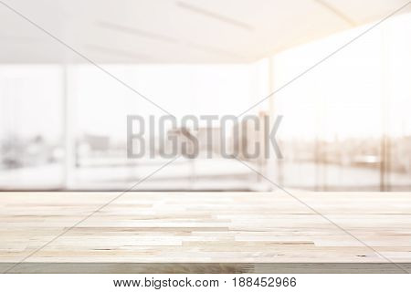 Wood table top in blur empty white office room with glass wall and city building view in background - can be used for display or montage your products