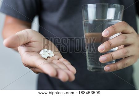 Man Hand And Water Drug , Medicine ,herbal Supplement Pill,eating Healthy Drug Prescription For Trea