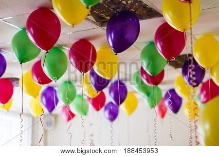 Many multicolored inflatable balls in the room