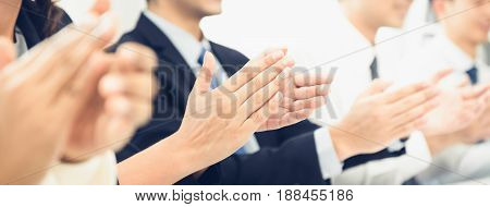 Group of business people clapping their hands at the meeting panoramic banner