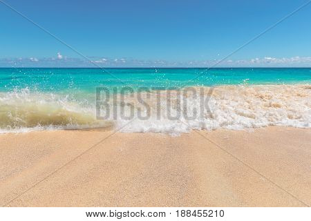 Sea surf on a beautiful beach in tropical island.